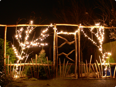Bespoke fencing frames and gate decorated with lights